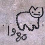 Das Bild zeigt einen Mauerausschnitt, auf den jemand eine Katze gesprayt hat.
